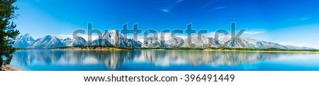 Grand Teton National Park, Wyoming.  Panorama showing reflection of mountains on Jackson Lake near Yellowstone. #396491449