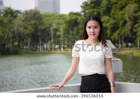 asia thai adult woman beautiful girl relax and smile in the garden #396536014