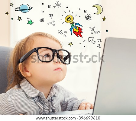 Idea Rocket concept with toddler girl using her laptop