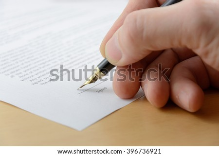 Business man signing document with fountain pen  #396736921