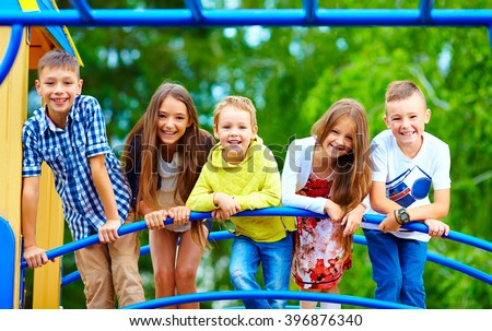 smiling excited kids having fun together on playground #396876340