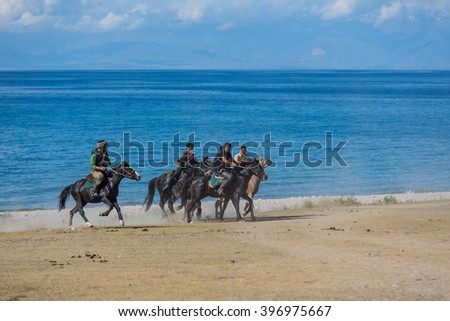 "Issyk-Kul, Kyrgyzstan - SEPTEMBER 15: National Games nomads ""Kokpar"" September 15, 2015 in Issyk-Kul, Kyrgyzstan #396975667"