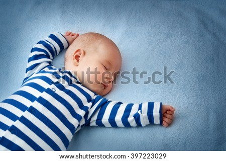 Baby sleeping in bed Royalty-Free Stock Photo #397223029