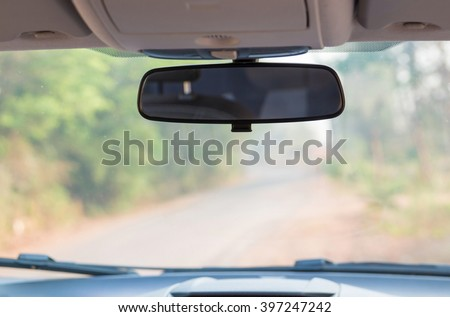 Car rear view mirror inside the car. Royalty-Free Stock Photo #397247242