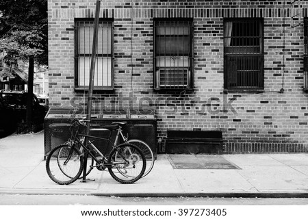 Vintage postcard of beautiful building, entrance door and bicycle, Manhattan New York, USA. Classic apartment in New York City. Black and white photo. Retro travel picture.