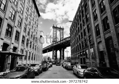Manhattan bridge seen from a brick buildings in Brooklyn street in perspective, New York, USA. Business and travel background. Vintage, retro postcard. #397278742