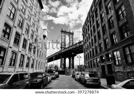 Manhattan bridge seen from a brick buildings in Brooklyn street in perspective, New York, USA. Business and travel background. Vintage, retro postcard. #397278874