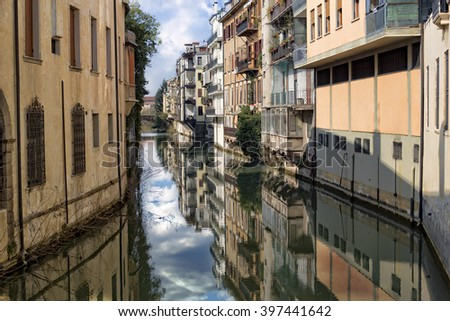 Typical houses along the river running through the town, Padua, Italy #397441642