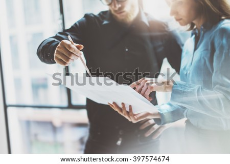 Team job succes.Photo young business managers  working with new startup project in modern office.Analyze document, plans. Holding papers, documents hands. Horizontal, blurred #397574674
