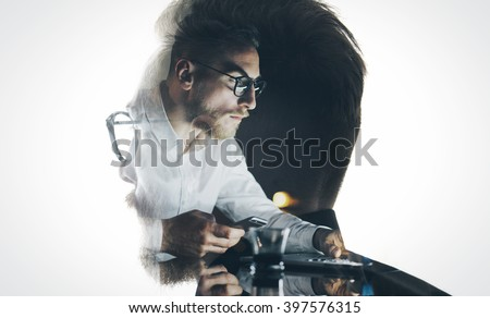 Portrait of stylish bearded lawyer wearing glasses and looking city. Double exposure, businessman working laptop at night, texting smartphone background. Isolated white. Horizontal Royalty-Free Stock Photo #397576315