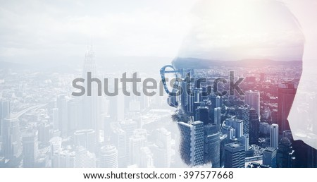 Closeup photo of stylish bearded banker wearing glasses and looking city. Double exposure, panoramic view contemporary megalopolis background. Space for your business message. Wide Royalty-Free Stock Photo #397577668