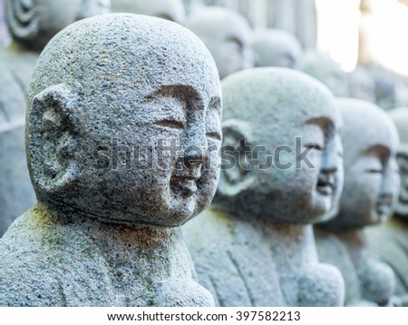 Lots of little monk buddha stone statues in Japan temple #397582213
