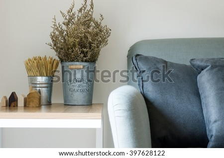 Modern sofa with dry flower in pot decorated on side table #397628122