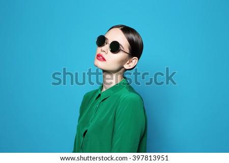 fashion model in sunglasses , beautiful young woman. Studio shot #397813951