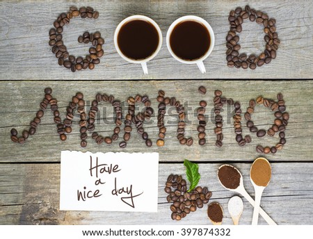 good morning and have a nice day concept - coffee beans, Cup of black coffee, heart from coffee beans, coffee leaves. Toned, selective focus image. lovely message