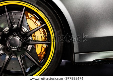 Part of modern new wheel car with disk brake pad Royalty-Free Stock Photo #397885696