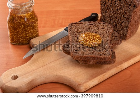 Sausage sliced with a knife on a wooden table. Sausage on wooden table #397909810