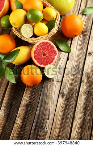 Citrus fruits on a brown wooden table #397948840