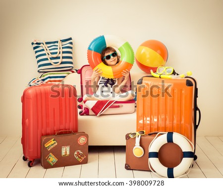 Happy child ready for a summer vacation. Kid having fun at home #398009728