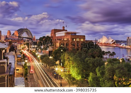 Aerial elevated view of The Rocks historic district in Sydney CBD as Sunset when bright lights illuminate city streets and landmarks. #398035735