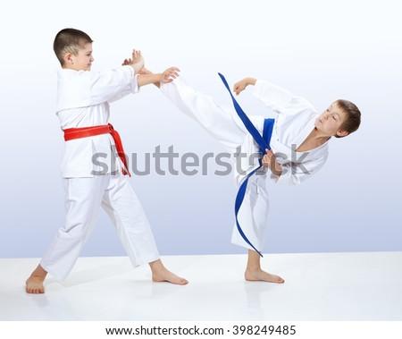 In karategi athletes train karate techniques #398249485