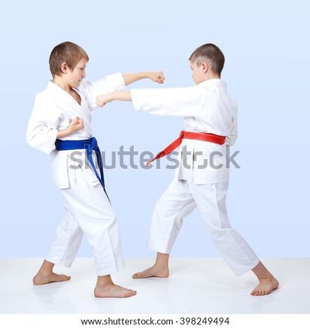 Boys beat punch arm toward each other #398249494