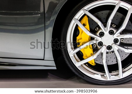 Part of modern new wheel car with disk brake pad Royalty-Free Stock Photo #398503906