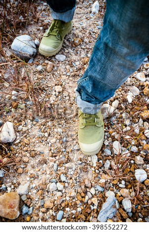 feet man in shoes on ground rock #398552272