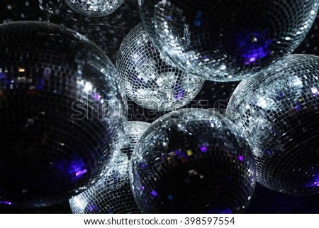 Disco balls in dark  Royalty-Free Stock Photo #398597554