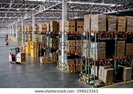 forklift in the large modern warehouse #398623363