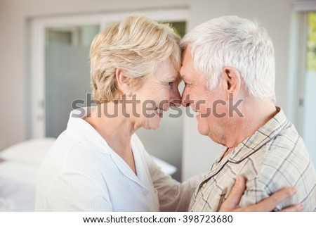 Side view of happy couple touching nose at home #398723680