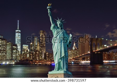 Manhattan skyline with Brooklyn Bridge at night and Statue of Liberty. #398731597