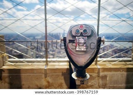 Tourist binoculars at the top of the Empire State Building in New York City #398767159