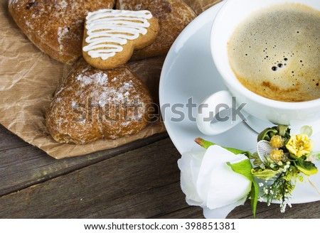 Heart shaped cookies , cup of coffee, white rose decoration, coffee maker. Romantic Breakfast. Toned, selected focus image