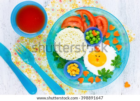 Easter breakfast for kids egg colorful vegetables, cute idea for healthy child food top view #398891647