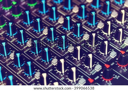 Detail of an audio mixer with a vintage effect