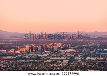 Phoenix Arizona with its downtown lit by the last rays of sun at the dusk.