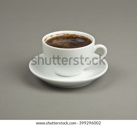 Cup of coffee and saucer on a gray background #399296002