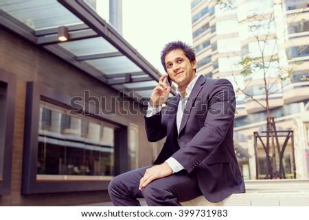Portrait of confident businessman outdoors #399731983