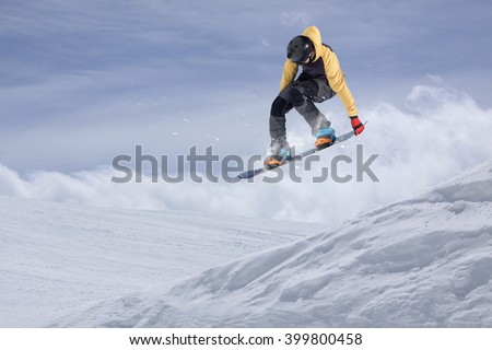 Snowboarder jumping on mountains. Extreme sport. #399800458