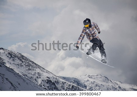 Snowboarder jumping on mountains. Extreme sport. #399800467