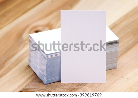Set of mock up business cards,set on top of wooden table.