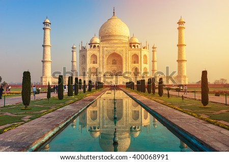 The Taj Mahal is an ivory-white marble mausoleum on the south bank of the Yamuna river in the Indian city of Agra, Uttar Pradesh. Royalty-Free Stock Photo #400068991
