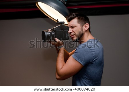 photographer with a medium format camera in the studio