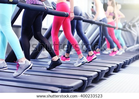 Group of fit women working out on treadmill in gym #400233523