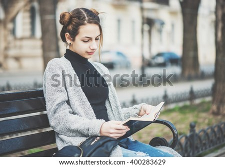 Young girl reading a book. Royalty-Free Stock Photo #400283629
