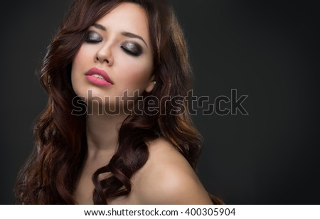 Young beautiful woman with long hair #400305904