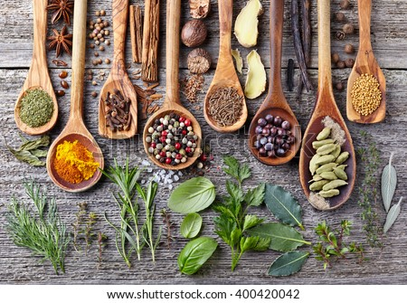Herbs and spices on a wooden board Royalty-Free Stock Photo #400420042