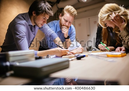 Group of designer working on project in workshop Royalty-Free Stock Photo #400486630