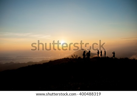 blurred peoples on top mountain st sunset #400488319